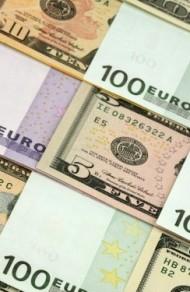 Евро остановил рост относительно доллара